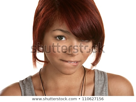 an embarrassed woman biting on her lip  stock photo © dacasdo