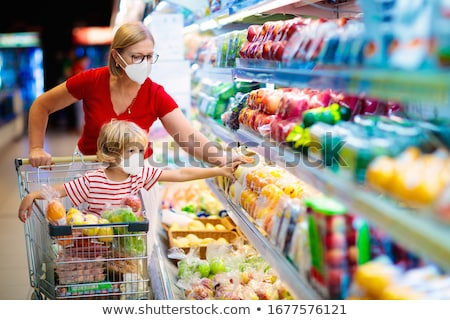 Stock photo: Family with children in cart in shop