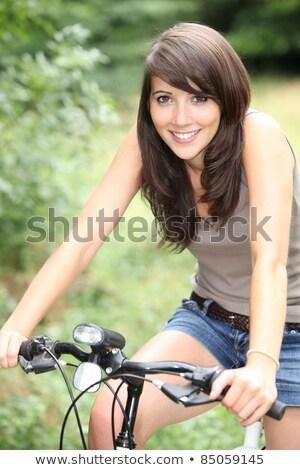 Stockfoto: Brunette · fiets · handen · ogen · natuur · groene