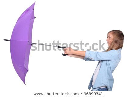 Young woman struggling with a purple umbrella on a windy day Stock photo © photography33