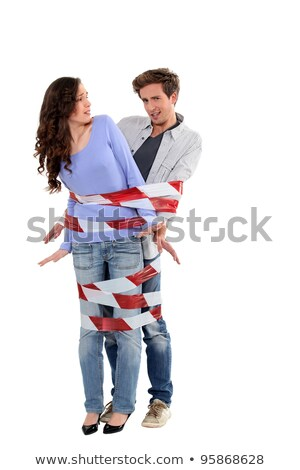 couple being forcibly held together by caution tape stock photo © photography33