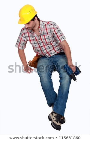 Construction worker sitting on blank space looking down Stock photo © photography33