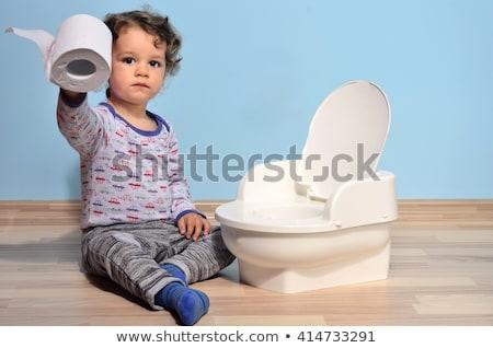 Little boy near blue potty Stock photo © erierika