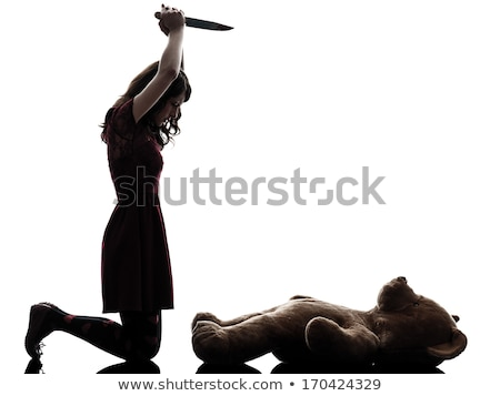 woman killing her teddy bear  Stock photo © feedough