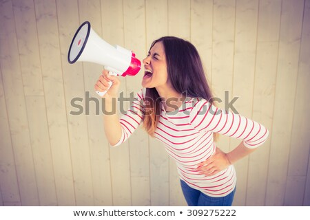 young woman shouting through a megaphone stock photo © photography33