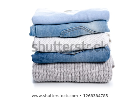 A pile of jeans on a white background Stock photo © evgenyatamanenko
