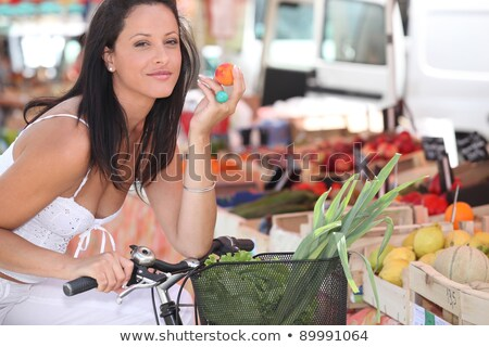 Stock photo: Woman with a bike and basket of market produce