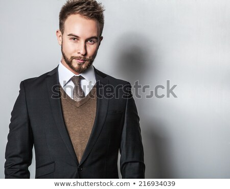 félhosszú · portré · elegáns · lezser · fiatal · fickó - stock fotó © stockyimages