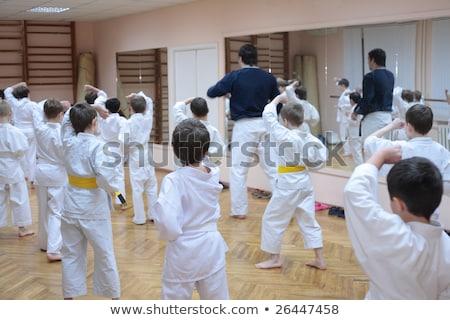 Karatê crianças treinamento esportes ouvir menino Foto stock © pekour