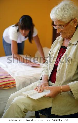 Helping senior woman on household chores Stock photo © photography33
