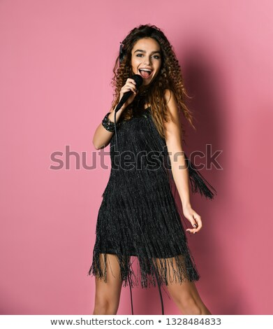 Girl singing in a pink dress stock photo © michey