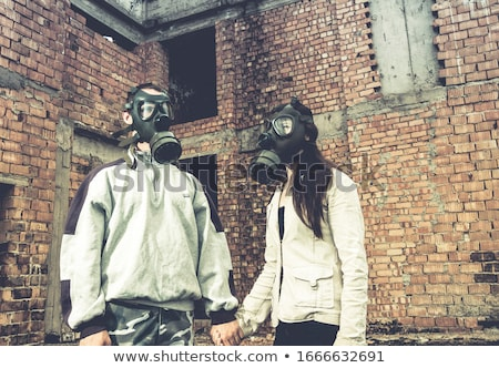 Pessoa máscara de gás fumador cigarro escuro segurança Foto stock © ctacik