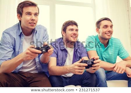Сток-фото: три · подростков · играет · Видеоигры · видео · темно