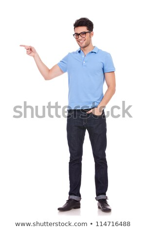 Smiling young man with hands in his pockets against a white background Stock photo © wavebreak_media