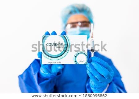 Nővér mutat injekciós tű kéz kamerába nő Stock fotó © wavebreak_media