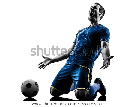 Shadow of a football player  stock photo © ABBPhoto