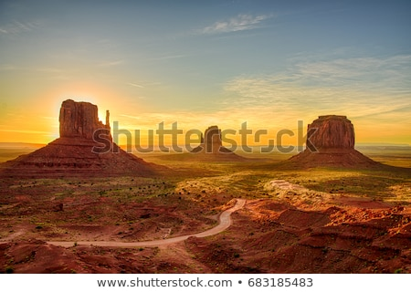 monument valley at sunrise stock photo © vwalakte