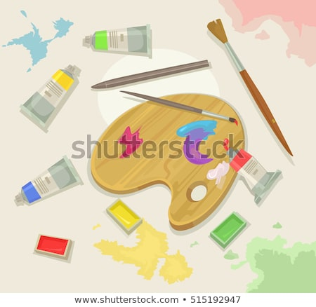 Brush and oil colors on a wooden palette Stock photo © Zerbor