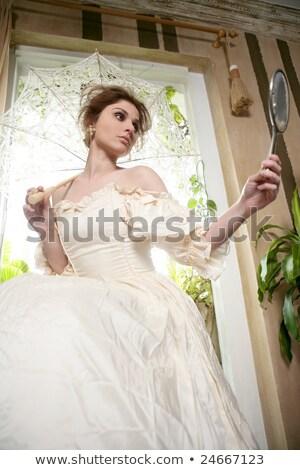 mooie · vrouw · witte · jurk · home · naar · hand · spiegel - stockfoto © lunamarina