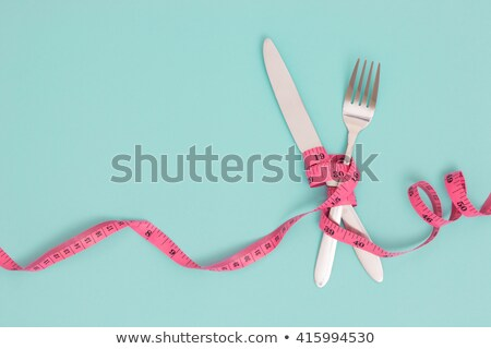 fork and measuring tape stock photo © italianestro