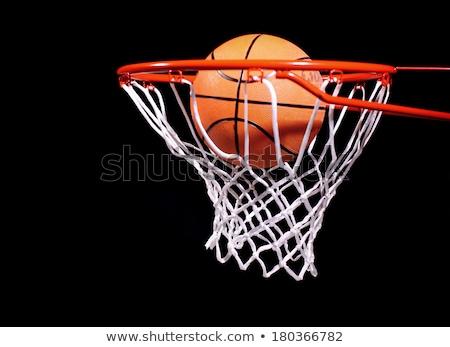 basketball ball and net on black background Stock photo © dotshock