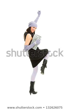 woman in knit wool hat and mittens dancing Stock photo © stepstock