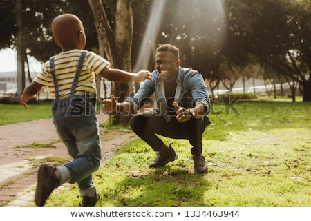 crouched casual man laughing outdoor stock photo © feedough