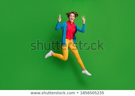 случайный женщину оба рук воздуха Сток-фото © feedough