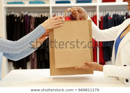 Authentic beautiful woman shopping in clothing store Stock photo © HASLOO