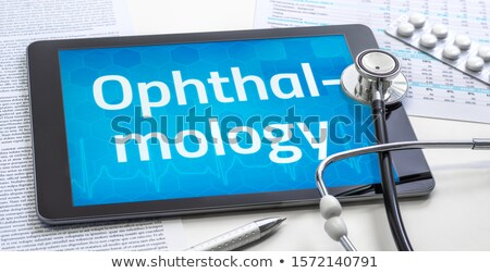 Tablet with the medical specialty Ophthalmology on the display Stock photo © Zerbor