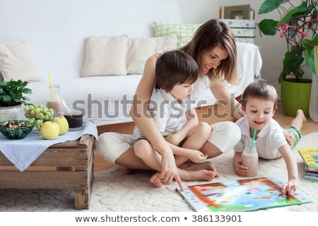 Young woman playing with boy Stock photo © monkey_business