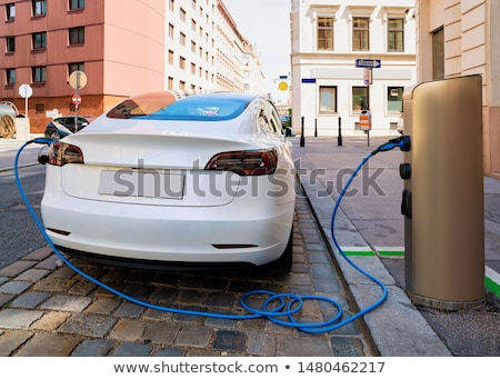 Foto stock: Recharge Electric Car In Free Charging Station Environmentally Friendly Transport