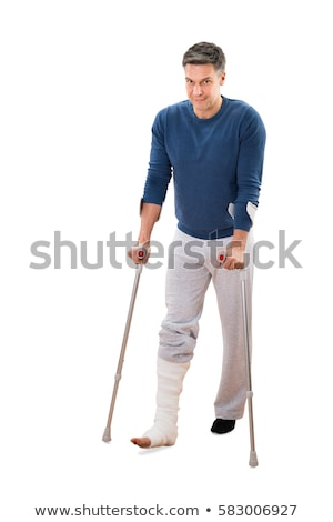 Man walking with crutches isolated on white Stock photo © stockyimages