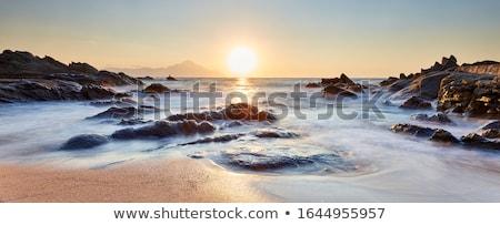Sea - Sunrise landscape over beautiful rocky coastline  Stock photo © Taiga