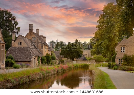 Cottages with Eye River in Lower Slaughter, Cotswolds, UK Stock photo © fisfra