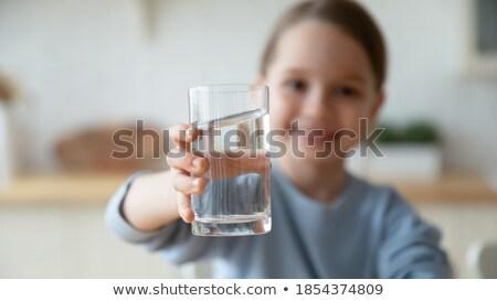 девушки стекла довольно шампанского женщину Сток-фото © anacubo