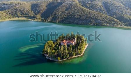 sziget · kolostor · park · víz · fa · természet - stock fotó © lianem