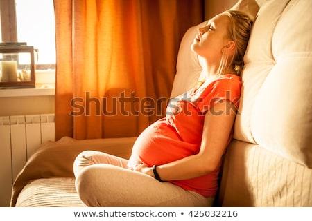 Terhes nő meditál gyönyörű ül kő piramis Stock fotó © phakimata