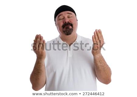 Devout religious man deep in prayer Stock photo © ozgur