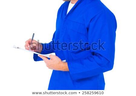 midsection of mechanic writing on clipboard stock photo © wavebreak_media