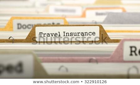 file folder labeled as travel insurance stock photo © tashatuvango