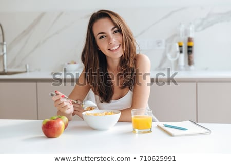 young woman preparing breakfast or about to have breakfast stock photo © nito