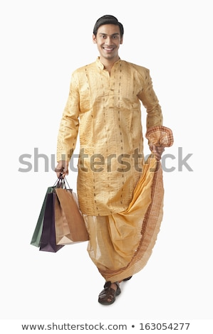 Bengali man carrying shopping bags and smiling Stock photo © imagedb