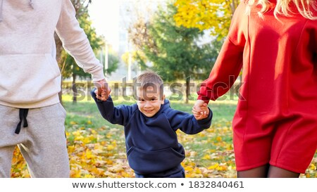 young woman with leaves in hands in jump in wood in autumn stock photo © paha_l