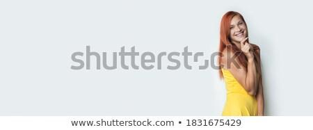 Modelo vestido rojo plantean tocar barbilla rizado Foto stock © feedough