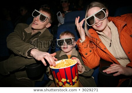 family in stereo cinema. focus on popcorn Stock photo © Paha_L