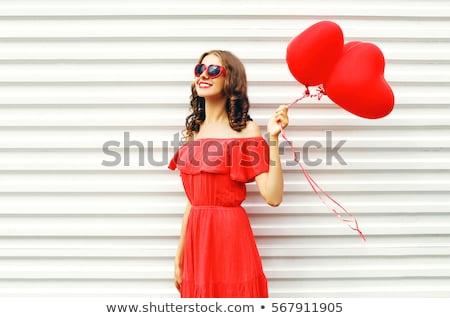 mosolyog · vonzó · lány · piros · pöttyös · ruha · park - stock fotó © ruslanomega