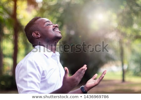 Foto stock: Christian Man Praying With Hands Crossed