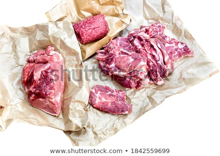 Pieces of fresh raw pork appetizing close-up on a white background. Stock photo © mcherevan