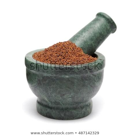 Organic Small Brown Mustard Seeds (Brassica juncea) in mortar. Stock photo © ziprashantzi